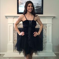 "Halloween or Costume Dress Sexy Corset-Style Costume Dress-Only worn once to a costume party.  Zips in the back and ties in the front.  The sides of the corset portion is like velvet.  The bottom is adorable-tutu style!  The full length is 35"" but from 31"" down it's sheer (the tutu portion).  100% Nylon. Perfect for Halloween!!!!  Size M/L but I wear a small and this still fits me.  I'd say fits S/M best! Selling for a family member.  All proceeds from this purchase will be donated to our…"
