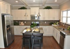 "Traditional Kitchen with Dynasty Hardware European 6"" Bar Pull, Quoizel Emery 1 Light Mini Pendant, High ceiling, U-shaped"