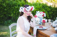 fun floral wreath that perfectly matches the florals used to accent the tablescape