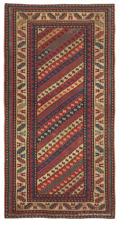 GENDJE, Southern Caucasian, 3ft 10in x 7ft 6in, Circa 1875. NEW ARRIVAL! Prodigious clarity of motifs and a profoundly elemental palette of mature natural colors immediately distinguish this stellar 140-year old Caucasian Gendje antique rug. Tremendously robust and graphic zigzag borders create an atmosphere of vibrant energy that is heightened by their simplicity.