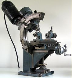 Looks like a gear cutting mill, I haven't seen one so just guessing…
