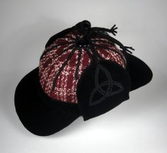 Wool plaid with black velveteen visors and embroidered earflaps.