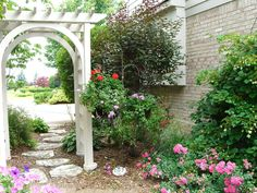Add a simple garden gate to your garden for visual interest. Decorate with string lights for a festive look.