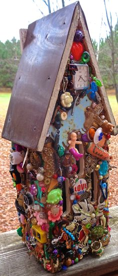 This is a butterfly house made with found 'junk'. Made 10/2014. Deb Hall