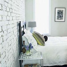 Whitewash your interior exposed brick for a fresh look. | Photo: Erik Johnson | thisoldhouse.com