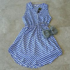 Everly Chevron dress Brand new and never worn, super cute chevron dress from Everly. Color is in blue with white and perfect for the out doors! The top half is buttoned down with these cute pearl like buttons and has a semi hi-low bottom look. Everly Dresses