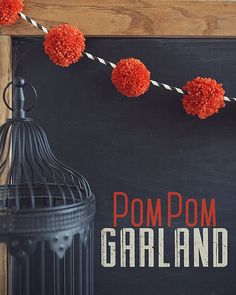Halloween Pom Pom Garland: This easy garland is a cute idea to hang on a mantle or doorway for DIY Halloween decorations.