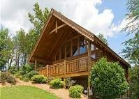 Nestled within the Alpine Mountain Village Cabin Resort, this beautiful Smoky Mountain log cabin is located just a short distance from the main Parkway of action packed Pigeon Forge. It has high beamed ceilings and clerestory windows which allow ample natural light to shine throughout the cabin.