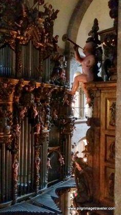 A cherub blows his trumpet, atop the cathedral organ, in Santiago de Compostela, Spain, the grand pilgrim's destination.