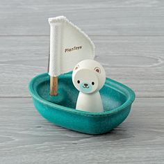 Shop Blue Sailboat Bath Toy.  The little animal in this boat can go on tons of adventures during bathtime.  It's on a colorful sailboat and makes the perfect bath toy for toddlers.