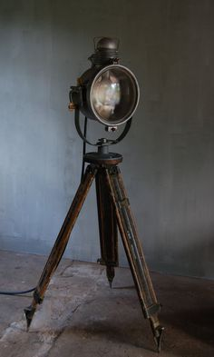 Amazing vintage Golden Glow train headlight mounted on a vintage US Army field tripod. Aluminum body with brass turn keys. Glass front opens to replace bulb. New heavy duty cord