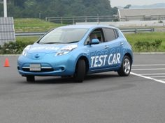 Nissan Leaf with automatic parking location to position over a wireless charging pad, Oppama, Japan