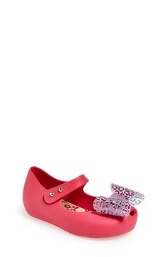 Free shipping and returns on Mini Melissa 'Ultragirl Minnie' Mary Jane Flat (Walker & Toddler) at Nordstrom.com. A pretty, structural bow tops a flexible, fruit-scented mary jane fashioned from waterproof PVC. A soft insole keeps little feet happy, and an adjustable hook-and-loop strap allows for easy-on, easy-off wear.