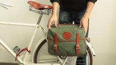 Tourbon Panniers made of quality waxed waterproof canvas Perfect as a bicycle storage for the market or a travel safari companions Come with 2 large compartments and a shoulder strap Bicycle Panniers, Bicycle Bag, Cruiser Bicycle, Bicycle Wheel, Cruiser Bike Accessories, Bag Accessories, Bike Frame Bag, Messenger Bag Patterns, Leather Bicycle