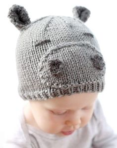 Free Knitting Pattern for Happy Hippo Baby Hat - Cassandra May at Little Red Window designed this knit baby hat that gets its personality from a some easypieces. The 12month size pattern is free at her website. Printable pdf version and other sizes from newborn to 2T are available on Etsy.