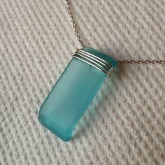 Wire wrapped blue glass pendant from Bombay Sapphire Gin bottle