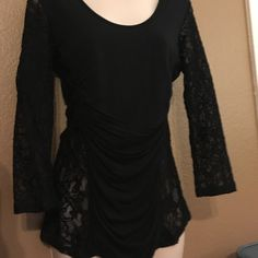 Guess Lace Back Scrumple Top The back and arms are sheer black stretchy lace and the front is cottony stretchy and laid out in a flattering gather. Casual Evening wear that feels right at home at your local blackjack table. Guess Tops Blouses