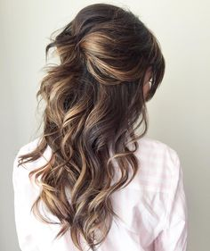 Don't want to outdo the bride but still wanna look awesome? If the bride is sporting a sexy and classy updo, the bridesmaid should choose a fun and fresh do like the half up half down hairstyle! Add voluminous curls for this full and bouncy look