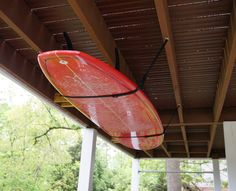 An adjustable, heavy-duty nylon ceiling storage strap system for surfboards.