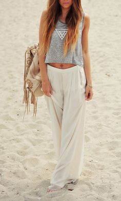 """Dressed in a pair of loose white cotton pants. . .she. . .joined the party on the beach."""