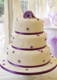 Wedding cake with purple daisies