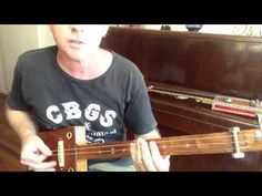 How to play Folsom Prison Blues on a 3 string slide cigar box guitar by Nigel McTrustry - YouTube