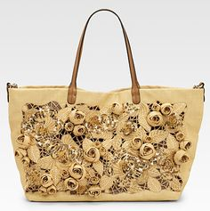 A glamorous Valentino straw and leather tote! Very pretty!