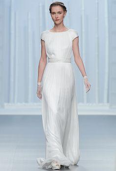 Brides.com: Rosa Clará - Spring 2016 Short sleeve pleated sheath with embellished waist detail, Rosa ClaráPhoto: Courtesy of Rosa Clará