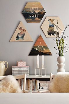 Loving the geometric shapes featured in this gallery wall! It's a fun mixture of word play and illustrations. What a great way to add personality to a wall.