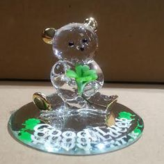 This little bear is armed and ready to wish you good luck, with a handmade porcelain four leaf clover, Swarovski crystal and 22k gold accents, and a mirrored base. Perfect for St Patrick's Day.