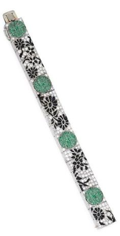 Platinum, Diamond, Onyx and Emerald Bracelet, Lacloche Frères, France, circa 1925. Of floral design, set with numerous rose, single and old European-cut diamonds weighing approximately 4.30 carats, the flowering vines set with calibré-cut cabochon onyx segments, spaced by stylized shou characters, symbolising longevity, set with calibré-cut emeralds, the reverse decorated with floral engravings, signed Lacloche Frères, numbered, with French workshop and assay marks. #Frères #ArtDeco…