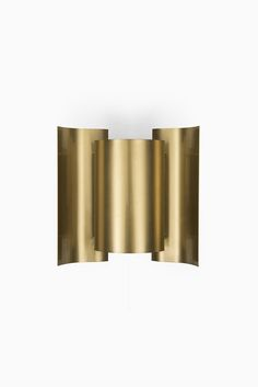 A set of 4 wall lamps in brass at Studio Schalling