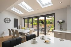 Like the sky lights. Would prefer the doors to have larger panes of glass Open Plan Kitchen Dining Living, Open Plan Kitchen Diner, Open Plan Living, Living Room Kitchen, Kitchen Layout, House Extension Plans, House Extension Design, Rear Extension, Living Room Extension Ideas