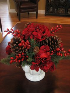 Red berries show off against these natural color pine cones. A simple, yest festive Christmas arrangement.