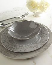 """Simple and Elegant    http://www.neimanmarcus.com  """"Sari"""" Oval Dinnerware  damask borders in tone-on-tone gray.  Hand-painted gray earthenware.      12-piece service includes four dinner plates, four salad plates, and four cereal bowls.      Dishwasher and microwave safe.      Made in Portugal."""