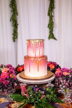 Two Tier Round Pink and White Ombre Wedding Cake with Gold Drip Frosting on Gold Cake Stand with Fuchsia and Plum Florals with Greenery | Tampa Wedding Cake Bakery The Artistic Whisk