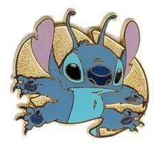 Walt Disney World (WDW) Cast Lanyard Series - Lilo & Stitch (Stitch). It depicts Stitch in front what looks like a gold leaf.
