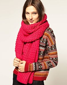 Mix bold sweater prints and bright scarves! The contrast is edgy and fun