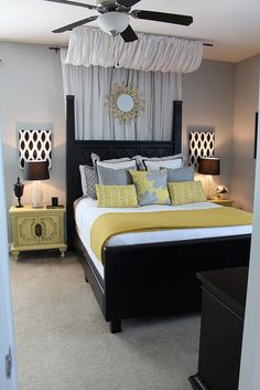 Yellow, grey, black color scheme. Headboard, curtains