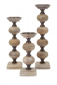 Versatile candlesticks that will compliment almost any interior and work with most candles. The Nahla Wood Candlesticks have a lovely stacked orb design, you receive three in graduated sizes.