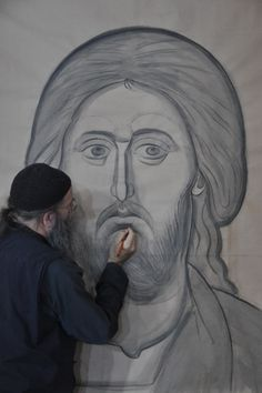 Fr. Patrick prepares a more refined drawing on paper.