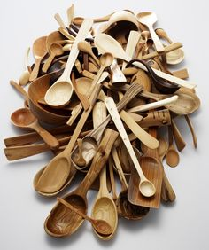 A quite impressive pile of wooden spoons by Nic Webb