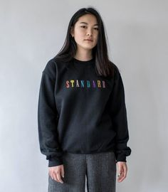 Inspired by London slang, our black Standard embroidered jumper features vibrant 90s font embroidery across the chest. - Unisex sizing for an oversized fit (model wears a small) - Chest sizing S 34-36, M 38-40, L 42-44, XL 46-48 - 50% cotton, 50% dry-blend polyester (Gildan) - Ribbed crewneck, cuffs and hem - Embroidered and finished in London  Duet is a brand set up by two married Londoners inspired by music, friends, culture and good old LDN. All products are made to order; as such, please…