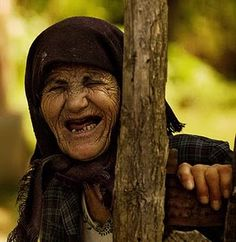 If just seeing this old woman so happy ... doesn't give you a smile that goes right to the center of your own deepest being...you've got a big problem. LOVE this PHOTO!!!  And I'd LOVE to interview this woman and get her story  :-)