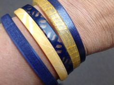 Show your West Virginia University pride with ecologically responsible, globally conscious jewelry by Color by Amber with me! Each bundle of 5 ecoresin bracelets is $43.94 + $2.50 s/h + your tax. They come in S, M, or L Shown here: 2 Sapphire, 1 Mesh, 1 Sunkissed, 1 Blonde Mohair