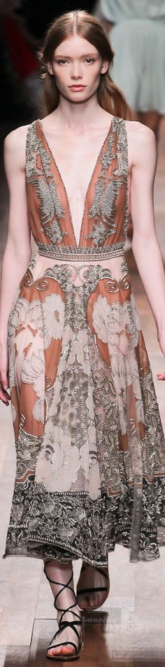Valentino.Spring 2015....simplicity of a form and the richest content...well,body is a body,but what makes her HER......Elegance of this renaissance compliment to a Donna = Bellissima is VERY Italian...Very....:)