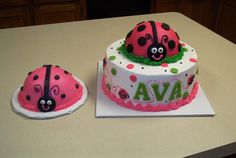 Ladybug cake - Fun cake for a little girl's 1st birthday.   The small ladybug is buttercream (makes it easier for the 1 year old to smash) the other ladybug is mmf.