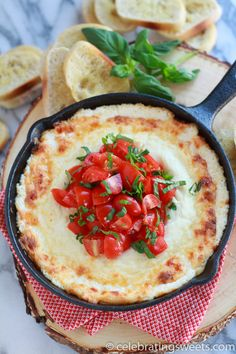 Warm and gooey four cheese dip, topped with fresh tomatoes and basil.
