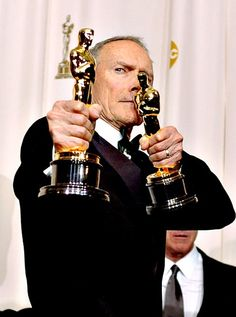 Clint Eastwood with both oscars for 'Million Dollar Baby' - Directing and also Best Picture in 2005.
