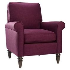 """Made in the USA, this raspberry-hued arm chair adds chic color to cozy reading nooks.  Product: ChairConstruction Material: Wood and fabricColor: RaspberryFeatures:  Roll arms and turned legsMade in the USA Dimensions: 37.5"""" H x 32"""" W x 32.5"""" D"""